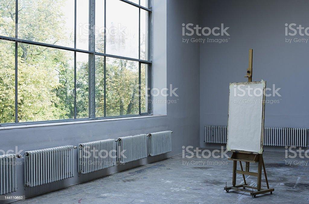 Easel in studio stock photo