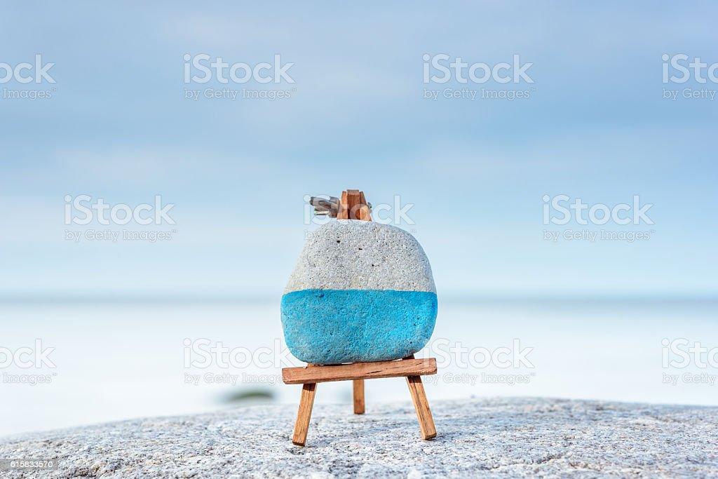 Easel on seashore stock photo