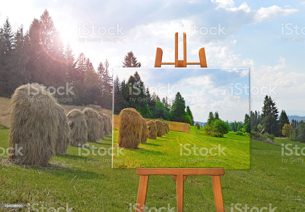 easel with a painting on a canvas on a landscape stock photo