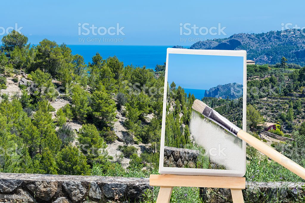 Easel with a picture on a mediterranean Landscape. stock photo