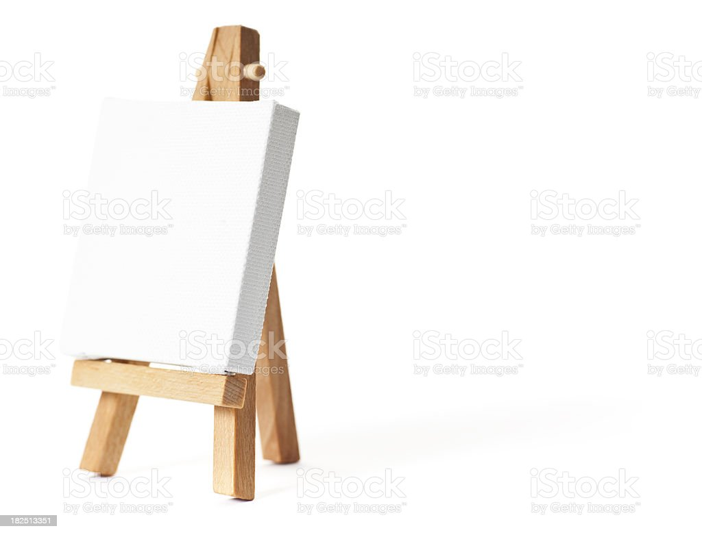 Easel with blank white canvas royalty-free stock photo
