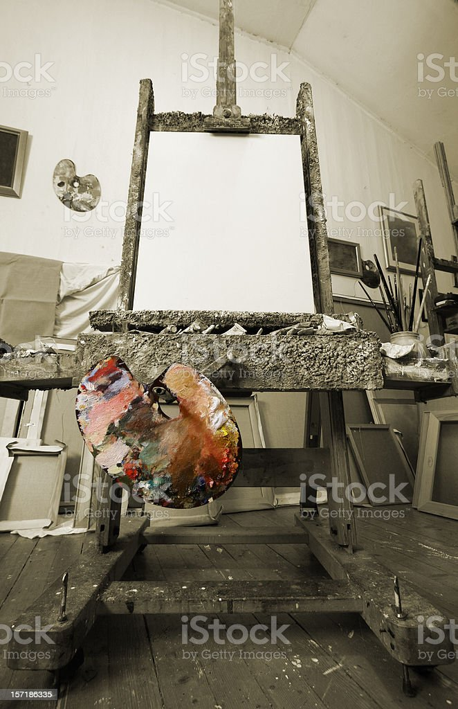 Easel with canvas in the artist's studio stock photo