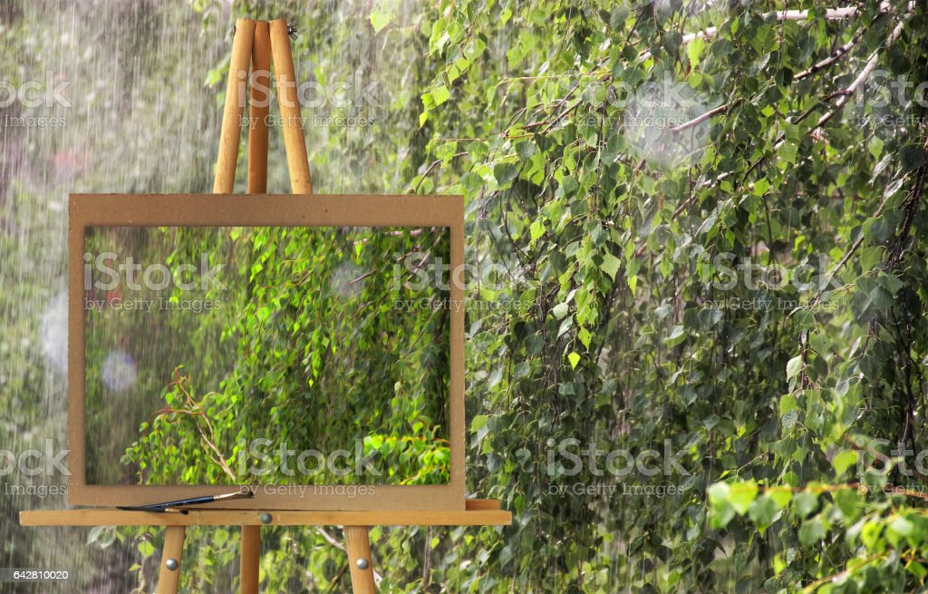 Easel with painting watercolor illustration rainy day stock photo