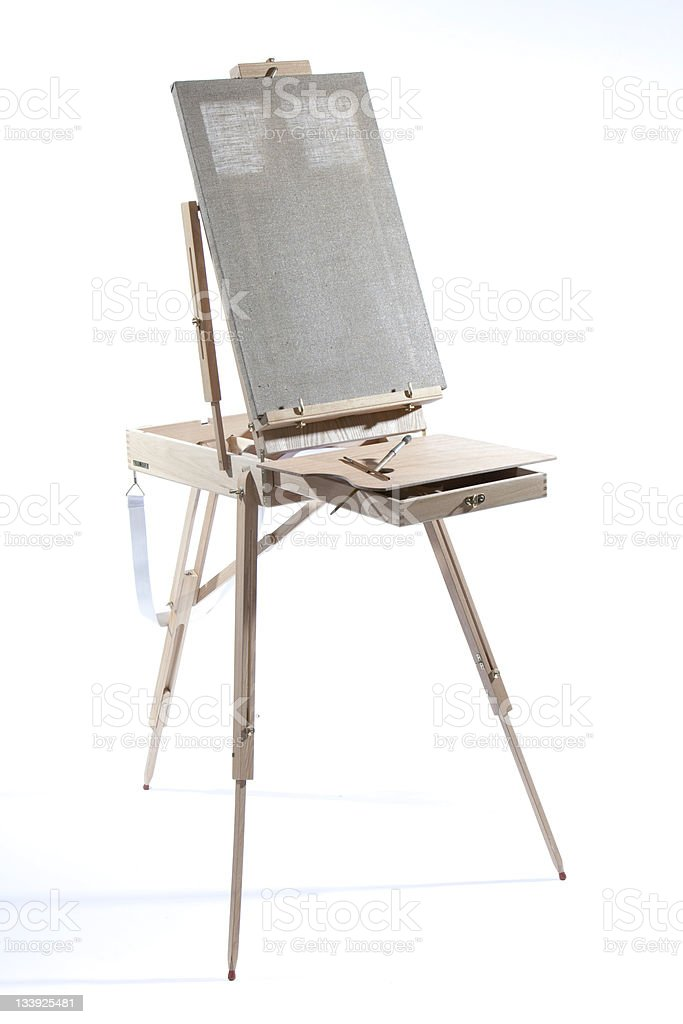 Easel with the blank canvas stock photo