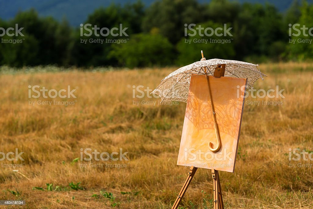 Easel with umbrella stock photo
