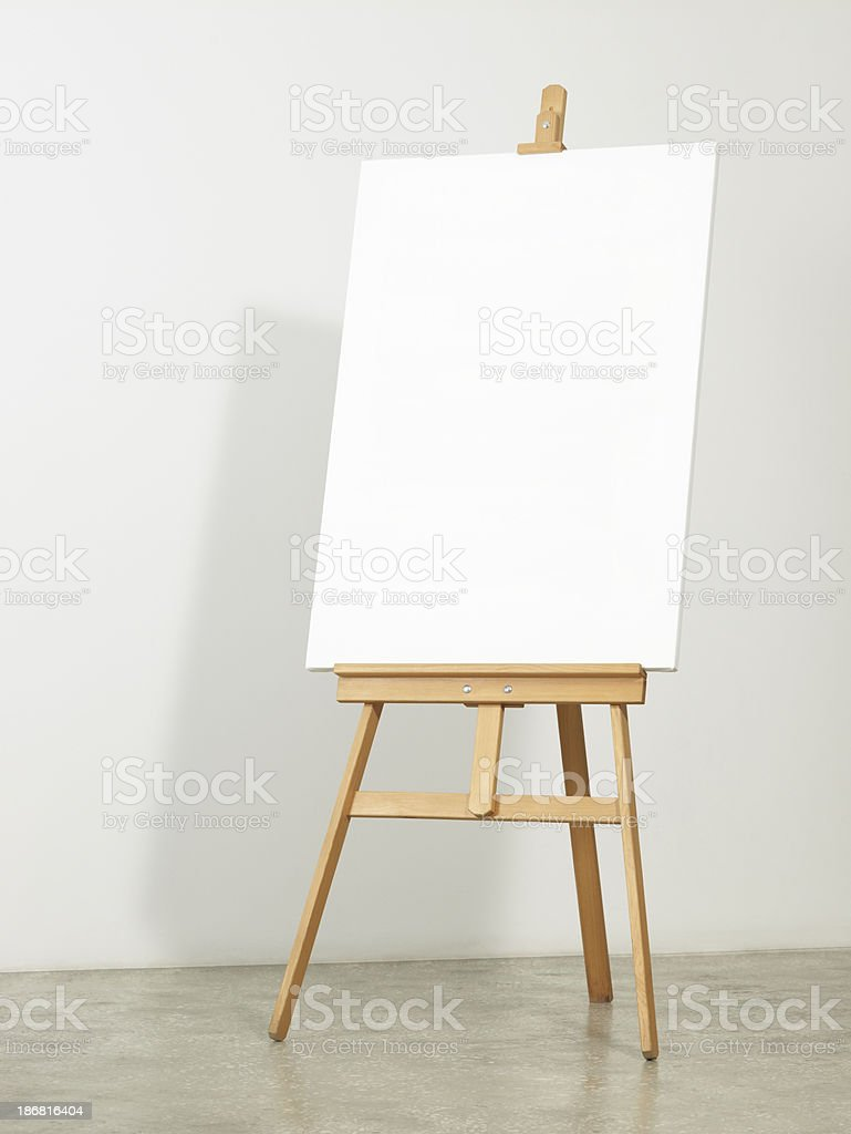 Easel with vertical canvas stock photo