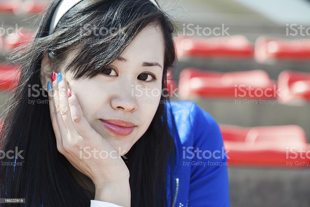 east asian college student in the sports stands stock photo