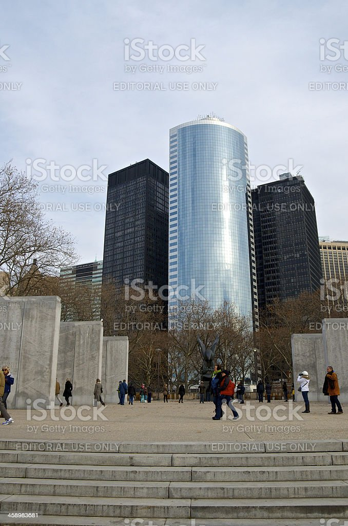East Coast Memorial visitors, Manhattan cityscape, Battery Park, NYC royalty-free stock photo