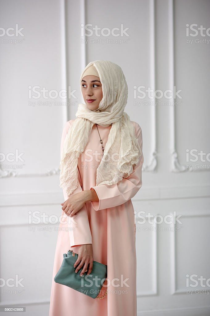 East girl in  bright Muslim dress,  shawl on her head stock photo
