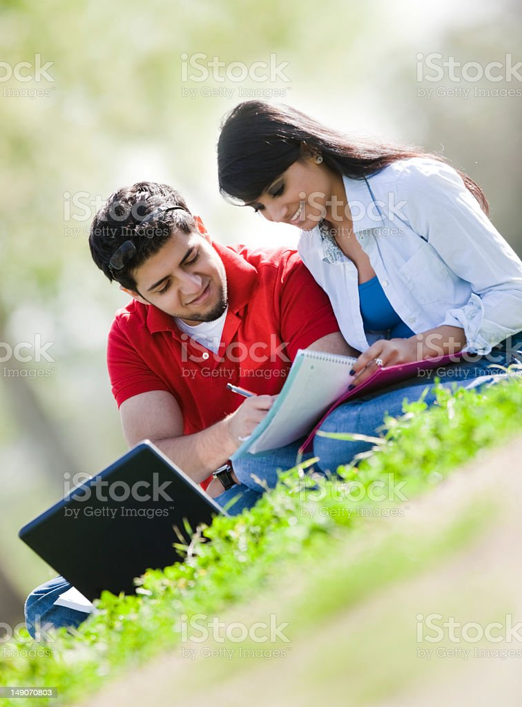 East Indian Couple Studying Outside royalty-free stock photo