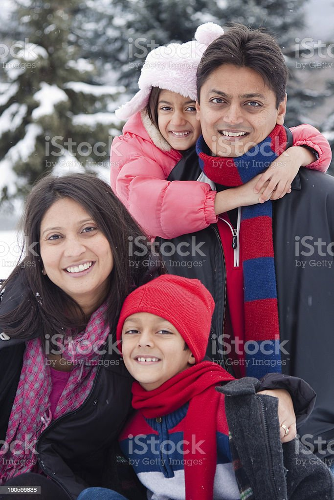 East Indian family playing in the snow royalty-free stock photo