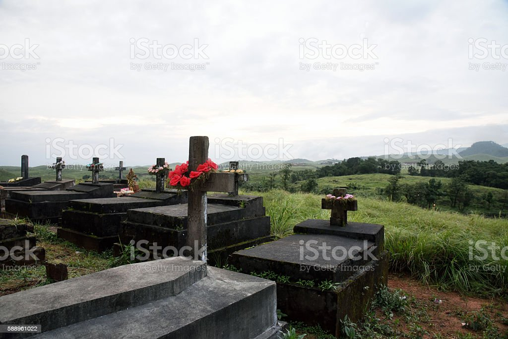 East Khasi Hills, Cherrapunji, rocky graves in hilltop Christian cemetery. stock photo