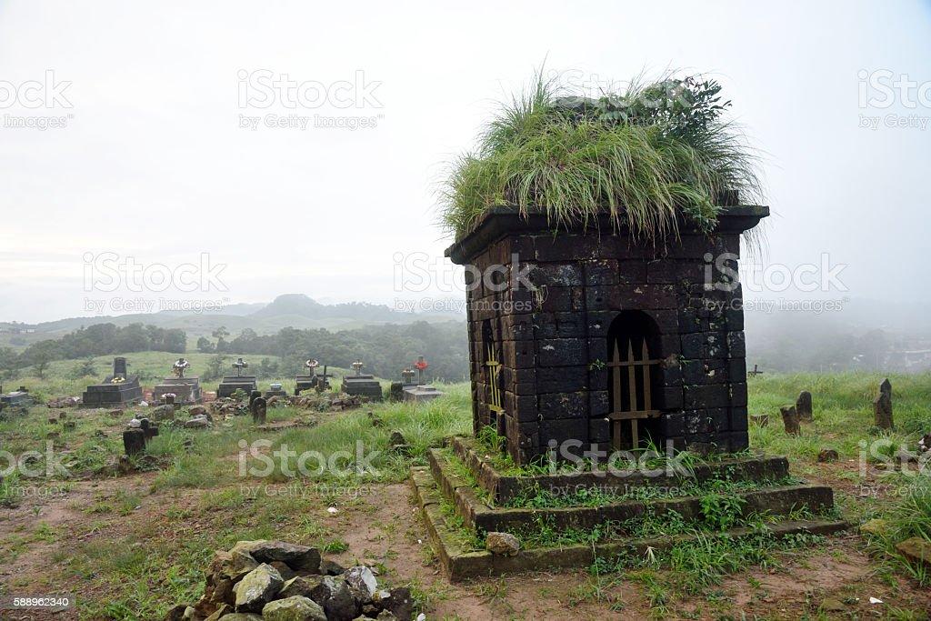 East Khasi Hills, Cherrapunji, rocky graves in hilltop Christian cemetery, stock photo