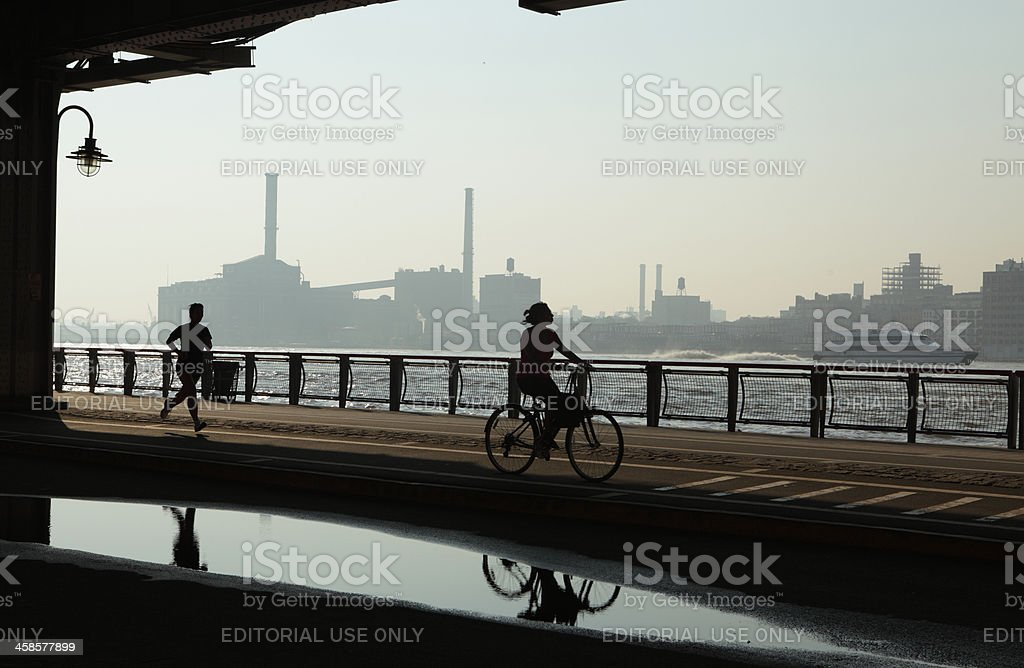 NYC East River commute walking cycling ferry riding stock photo