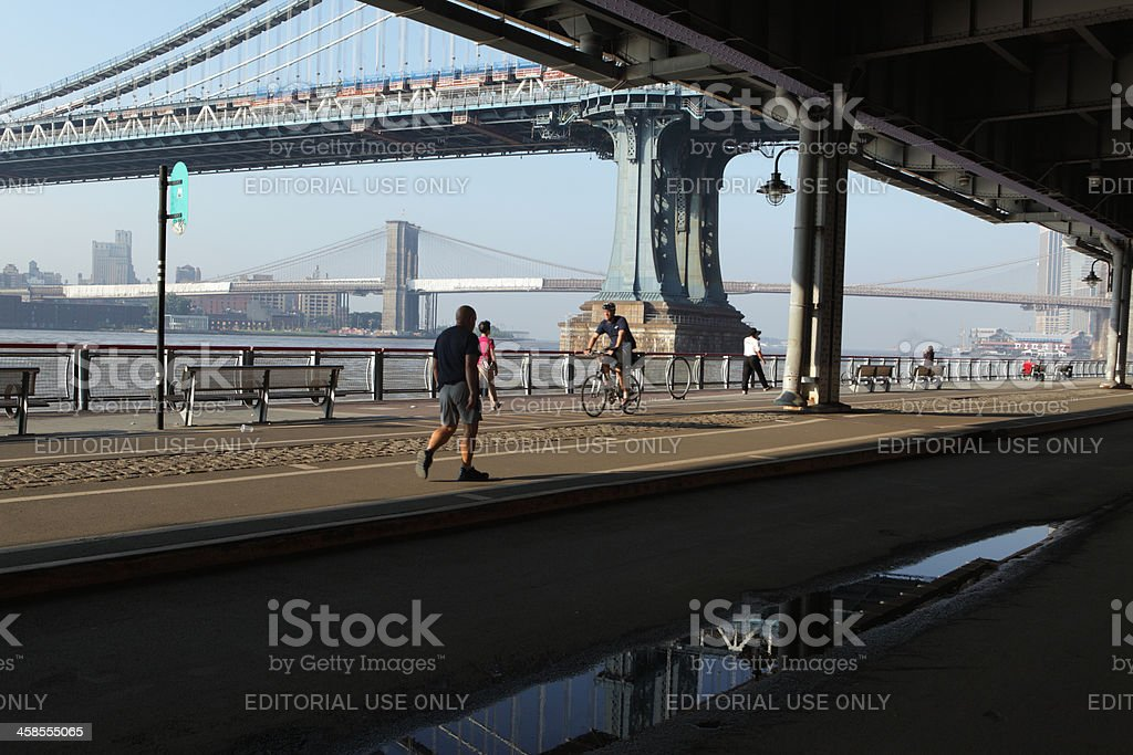NYC East River morning commute walking cycling stock photo