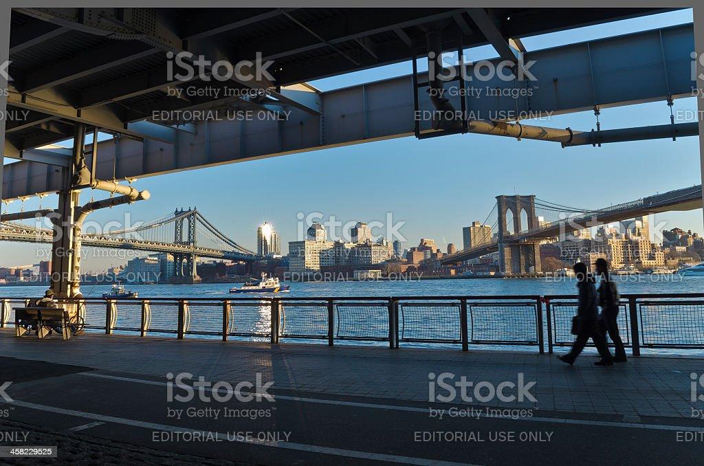 East River Sidewalk Brooklyn and Manhattan Bridges stock photo