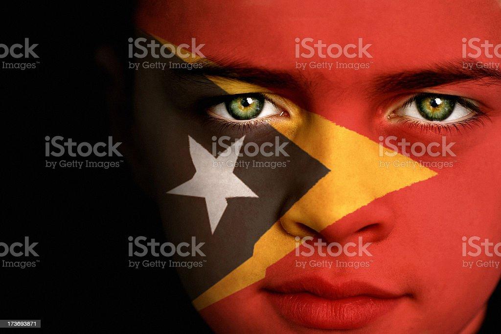 East Timor flag boy stock photo