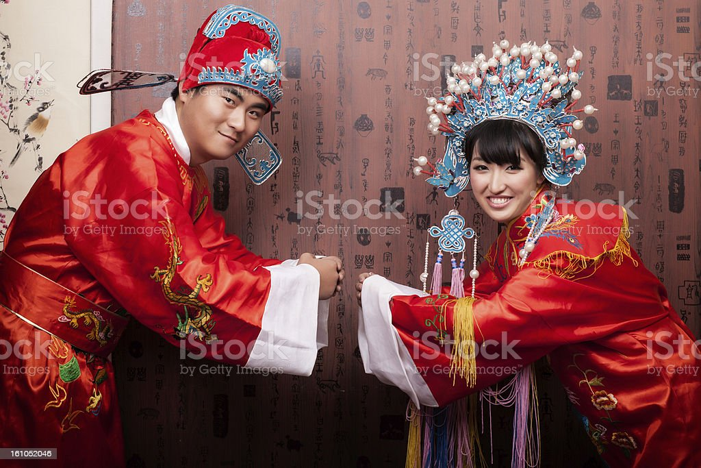 Easten Chinese Bride and Groom in traditional wedding ceremony stock photo