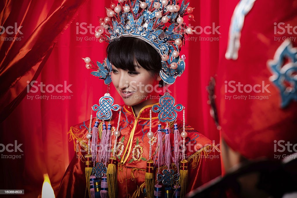 Easten Chinese Bride Beauty in traditional wedding clothes stock photo