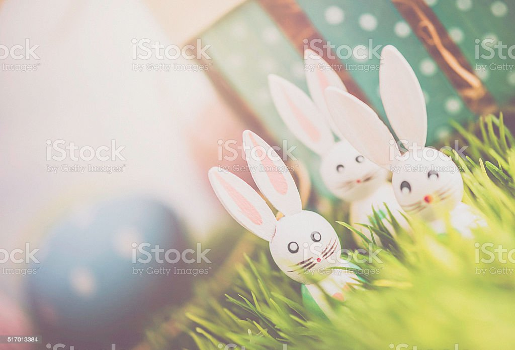 Easter arrangement with Easter basket, eggs and vintage Easter bunnies stock photo