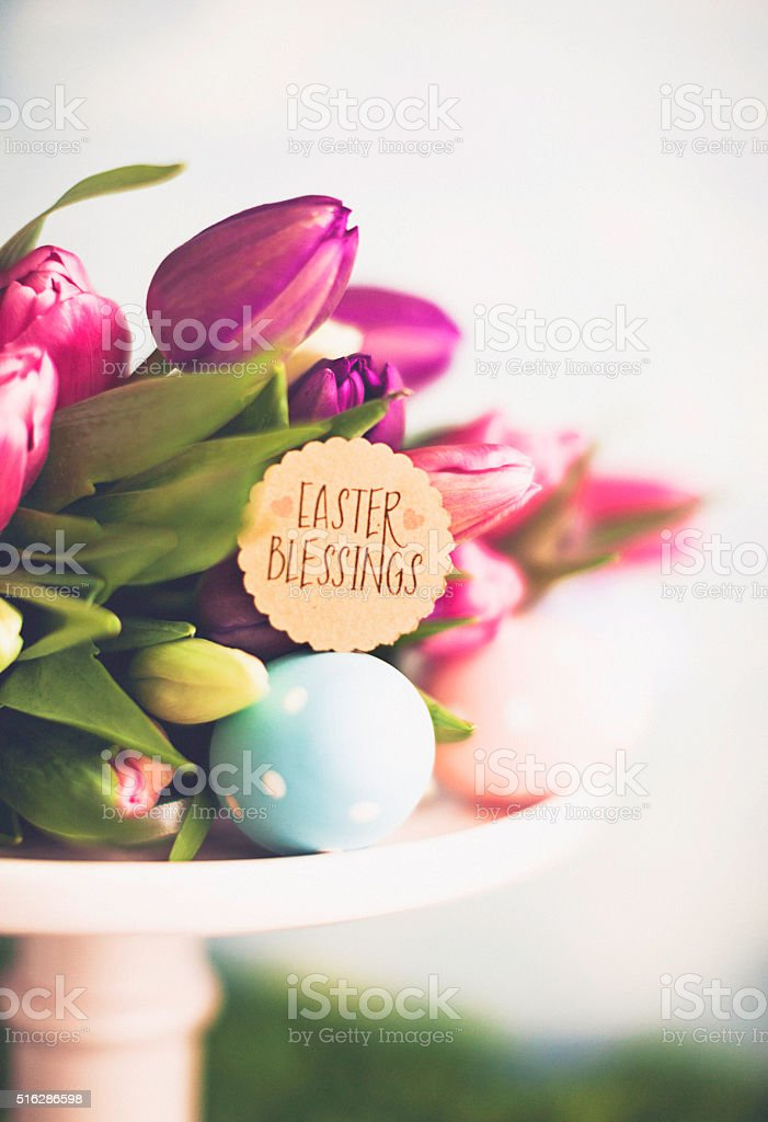 Easter arrangement with Easter tulips and blessings message stock photo