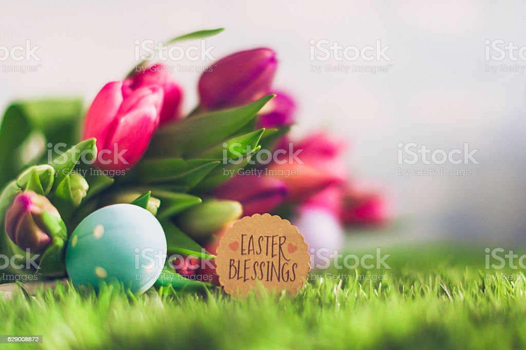 Easter arrangement with fresh tulips, Easter eggs and Easter message stock photo
