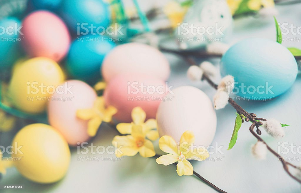 Easter arrangement with painted eggs, blossoms and pussy willow stock photo