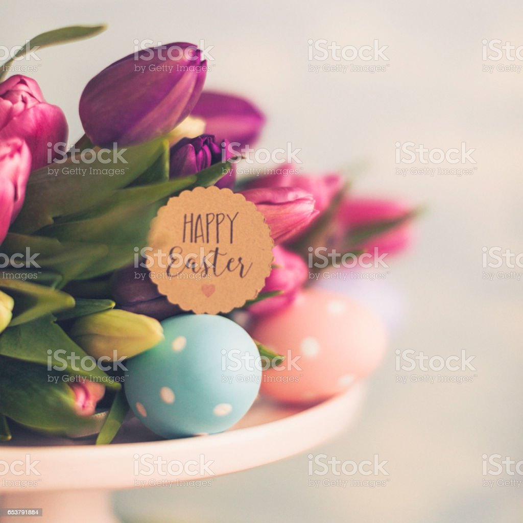 Easter arrangement with tulips and eggs stock photo