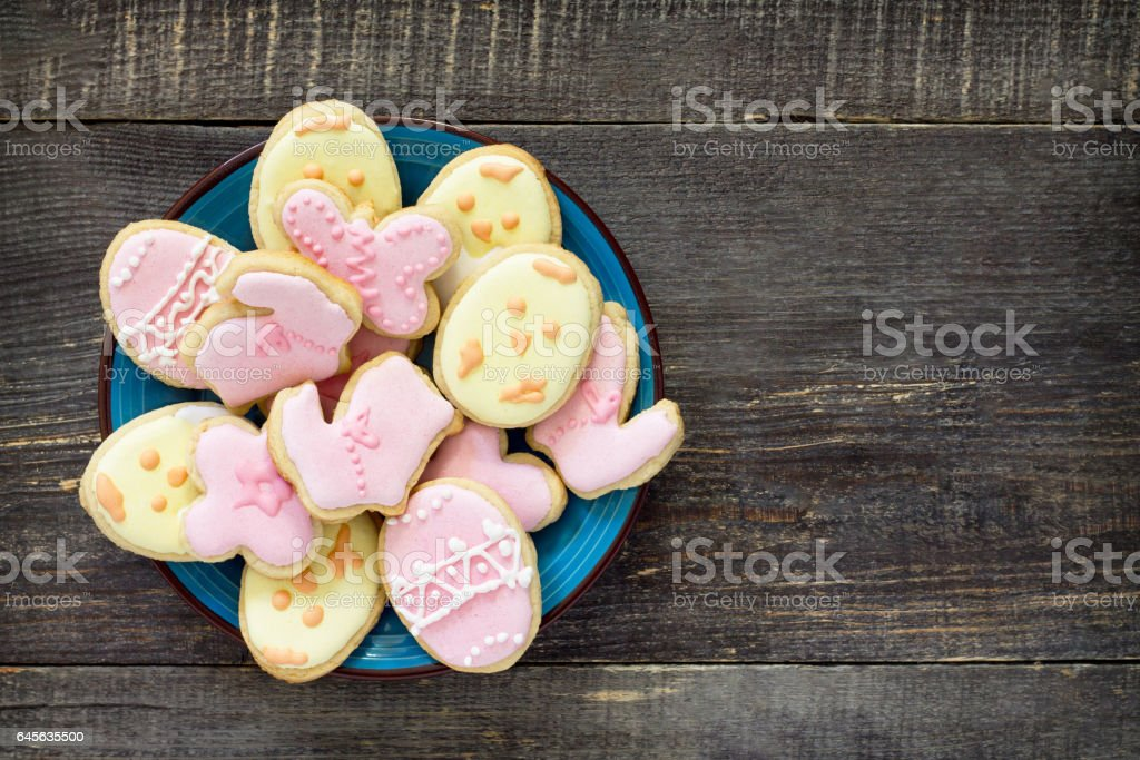 Easter background. Easter various cookies on a plate on a wooden table. Easter recipe. stock photo