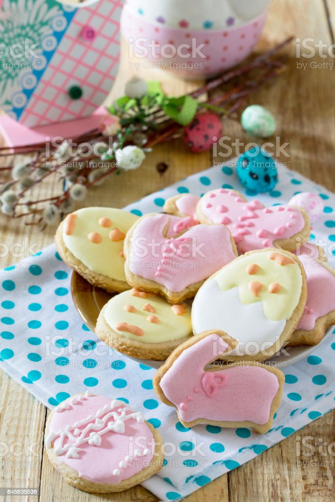 Easter background. Plate with delicious Easter cookies on a festive table. Easter recipe. stock photo