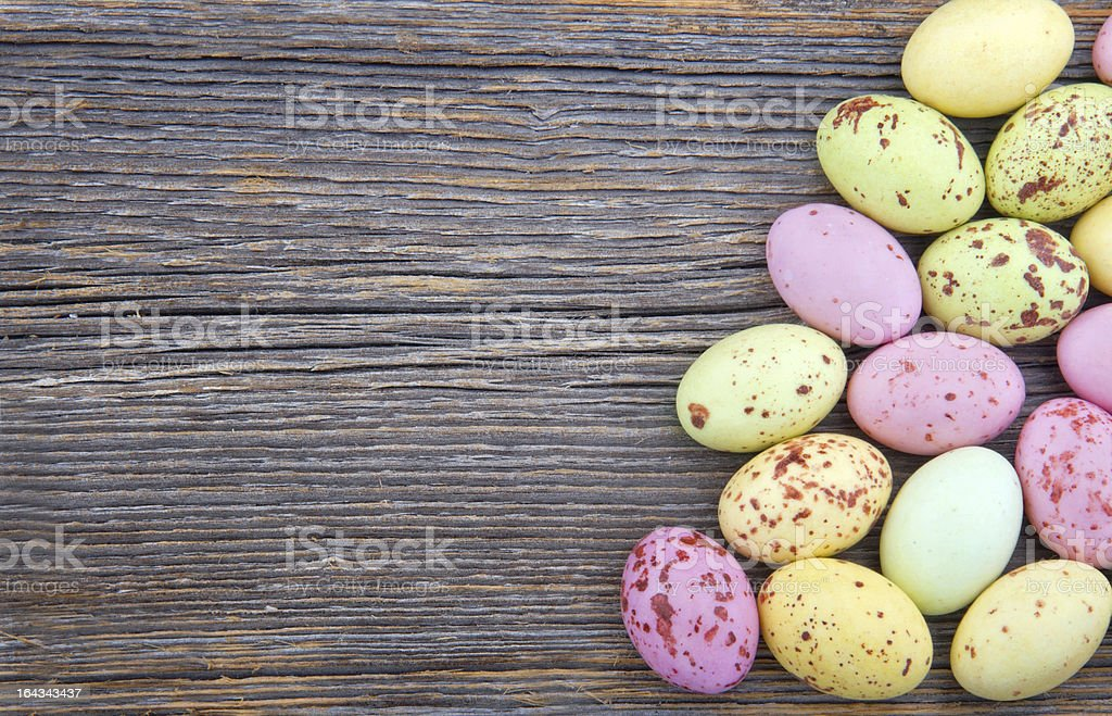 Easter background, small spotted chocolate eggs royalty-free stock photo