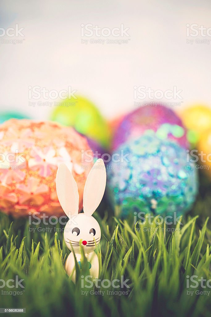 Easter background with glitter eggs and vintage Easter bunnies stock photo
