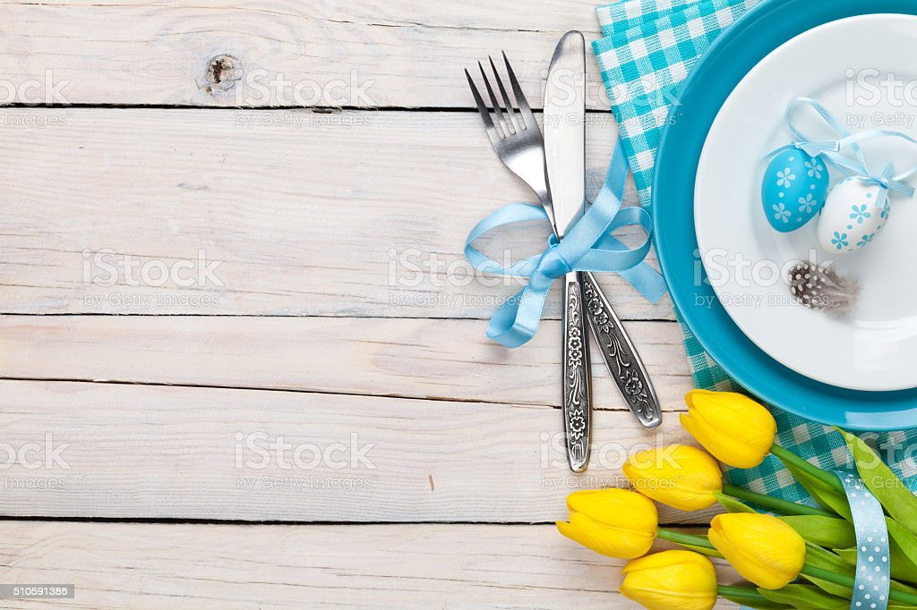 Easter background with yellow tulips and colorful eggs stock photo