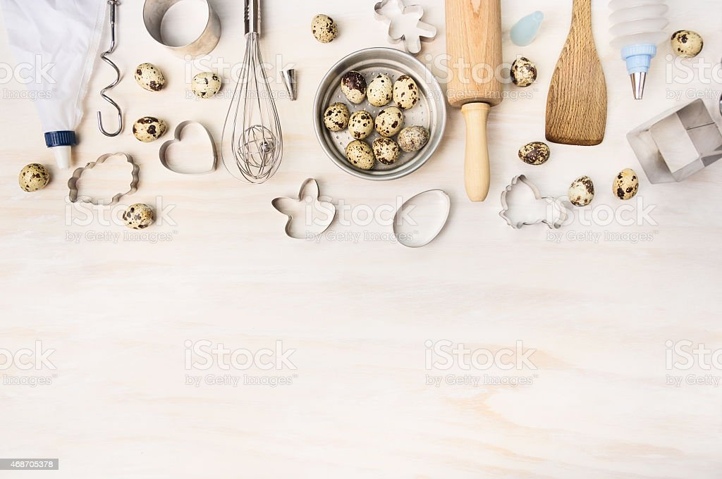 Easter bake tools with quail eggs and biscuit cutter stock photo