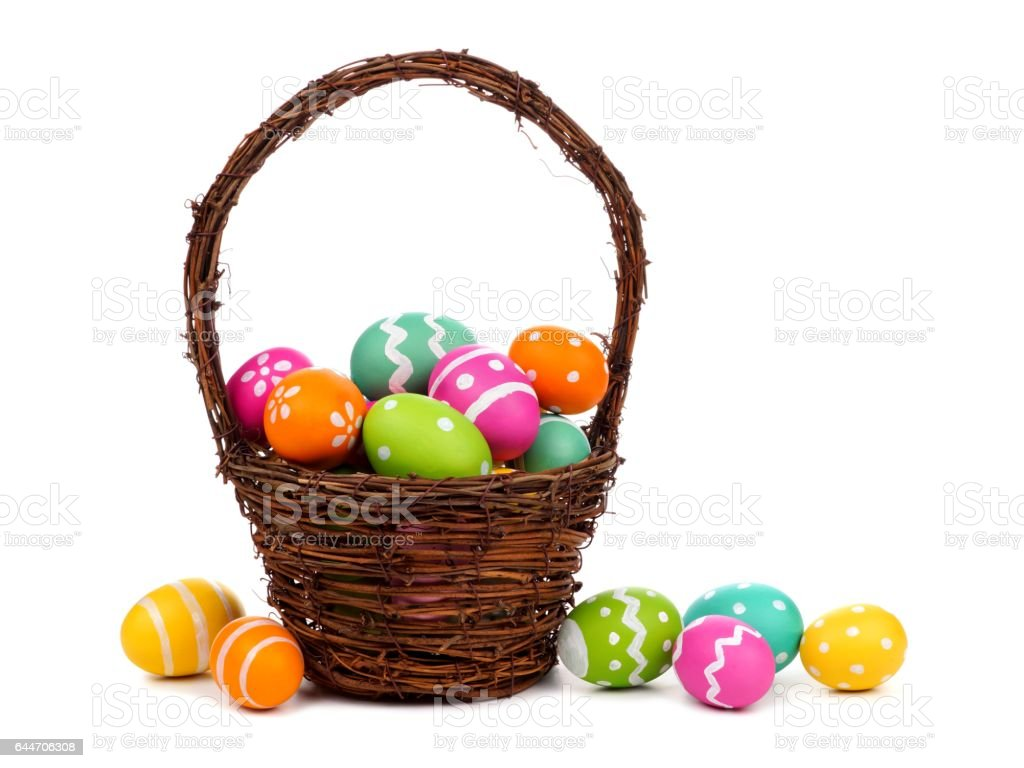 Easter basket filled with colorful Easter Eggs over white stock photo