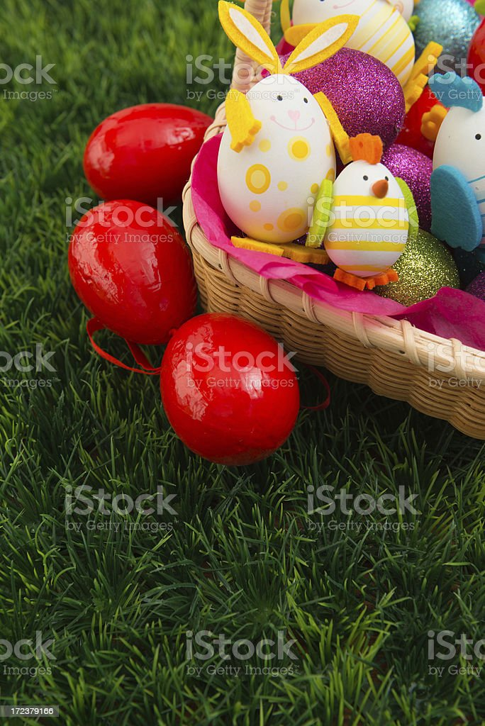 Easter basket with colored eggs royalty-free stock photo