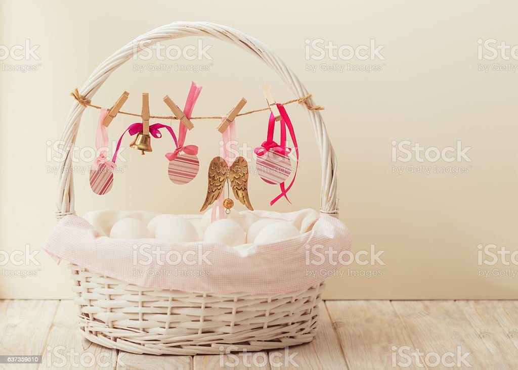 Easter basket with eggs and Easter decor. stock photo
