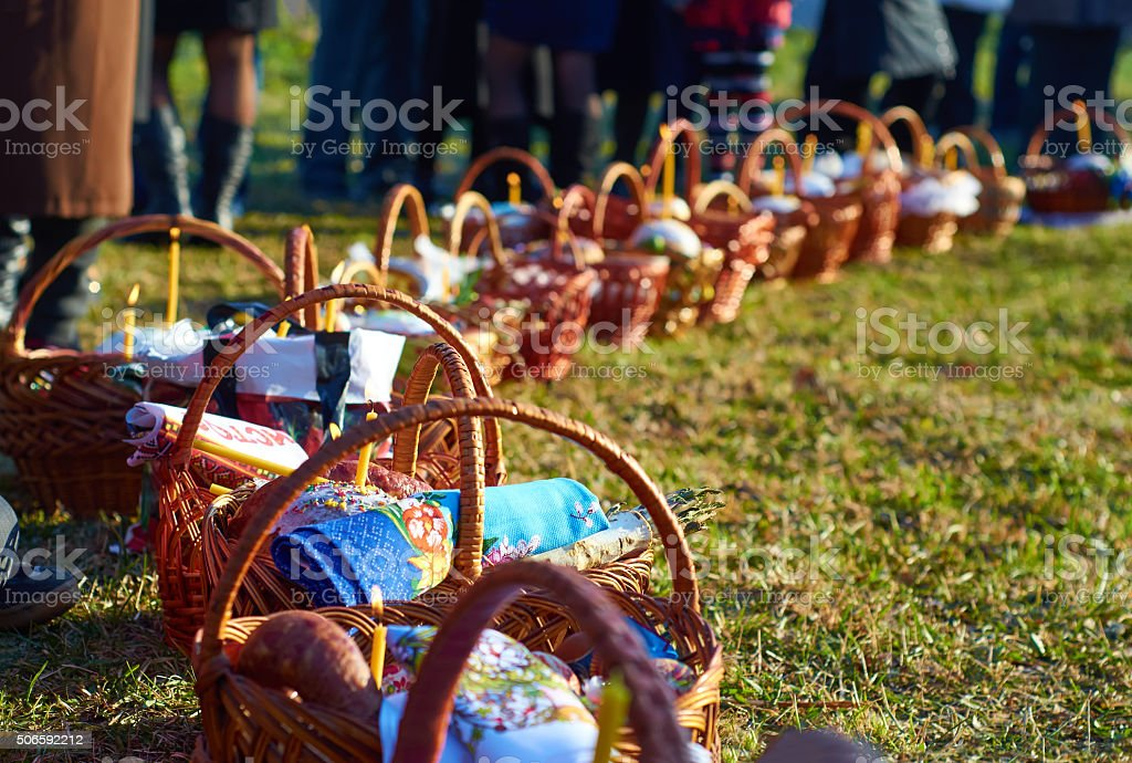 Easter baskets on green grass at sunny day. stock photo