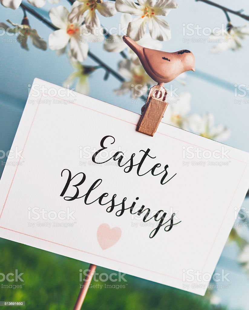 Easter blessings message with spring blossoms stock photo