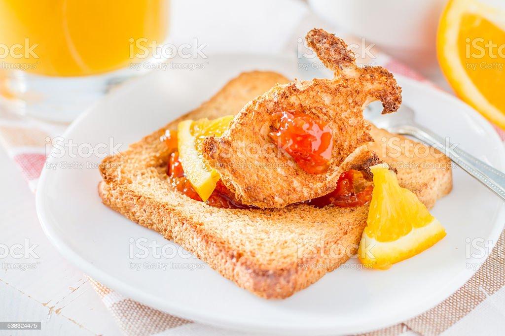 Easter breakfast - bunny shaped toast with jam, orange, juice stock photo