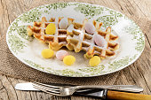 easter breakfast waffles with powdered sugar and small sugar egg