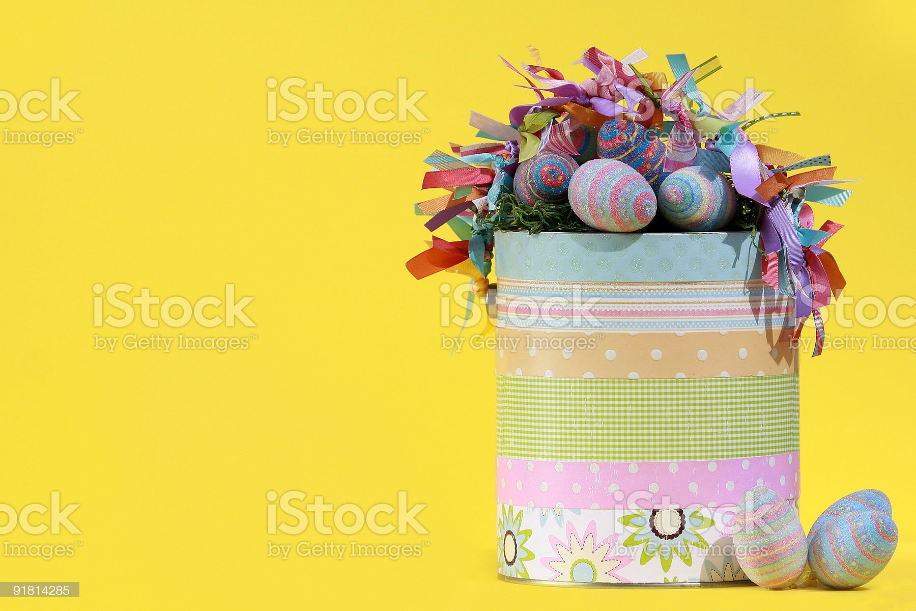 Easter Bucket on bright yellow background. royalty-free stock photo