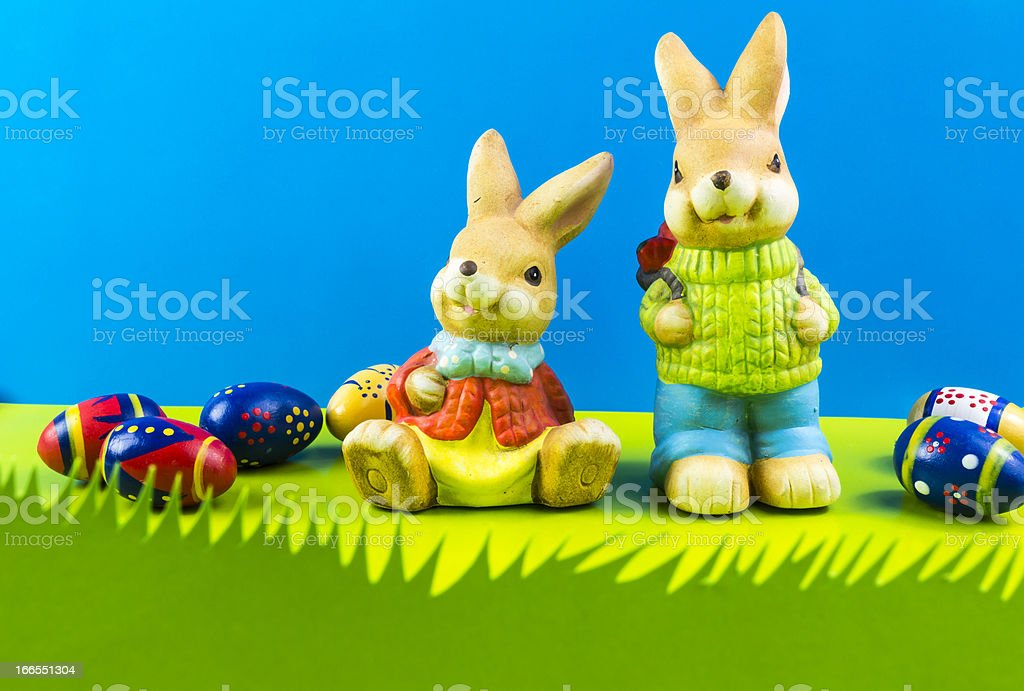 Easter bunnies on blue background royalty-free stock photo