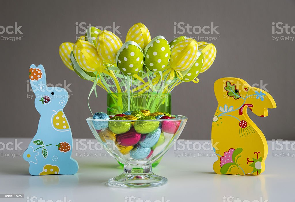 Easter bunnies with eggs and candies royalty-free stock photo