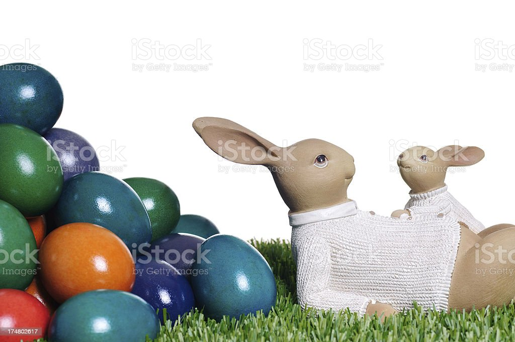 Easter bunnies with heap of eggs royalty-free stock photo