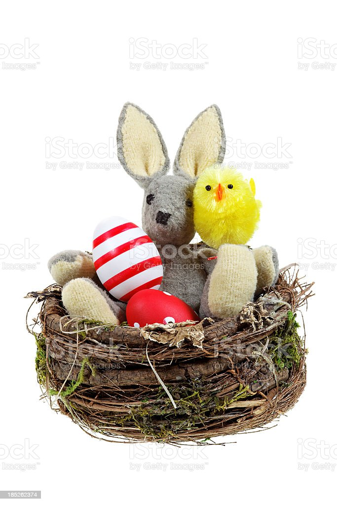 easter bunny and eggs in nest royalty-free stock photo