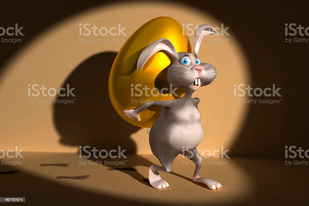 Easter Bunny and gold egg stock photo