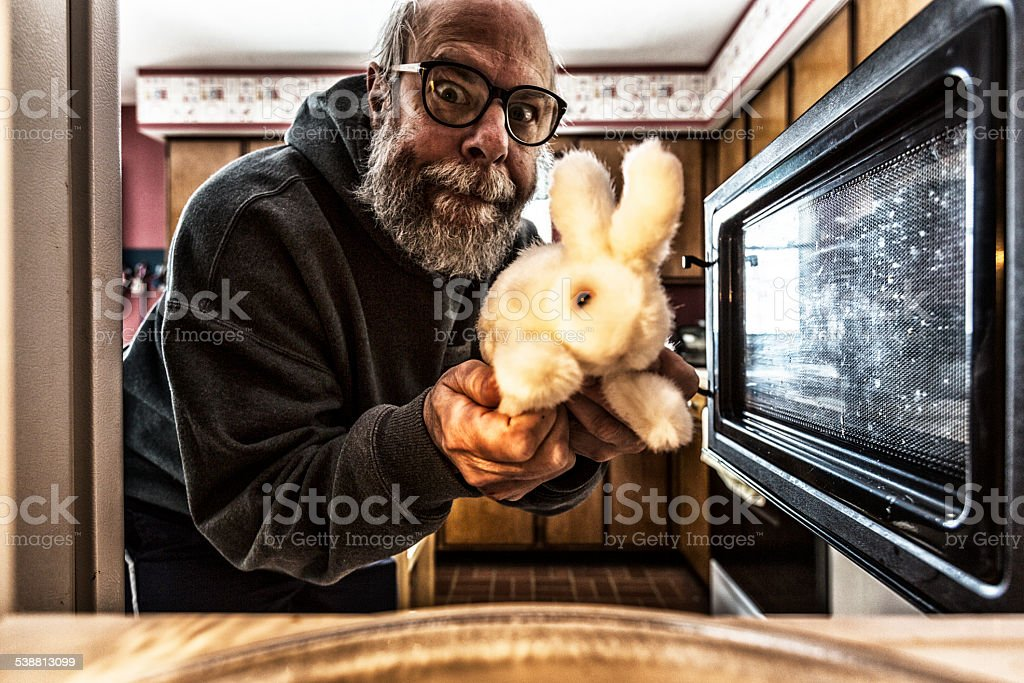 Easter Bunny And Grubby Senior Man Microwave stock photo