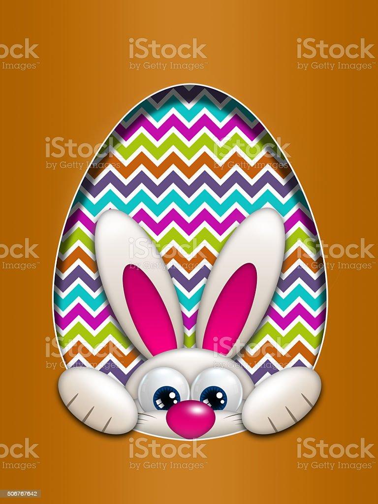 easter bunny hidden in egg hollow stock photo