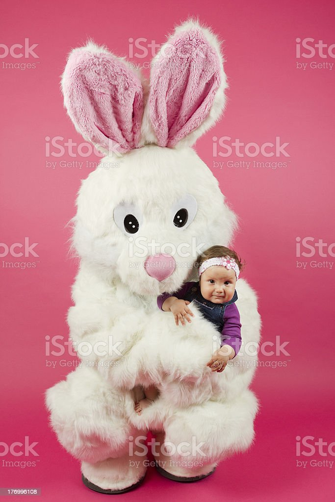 Easter Bunny Hugging Little Baby Girl stock photo